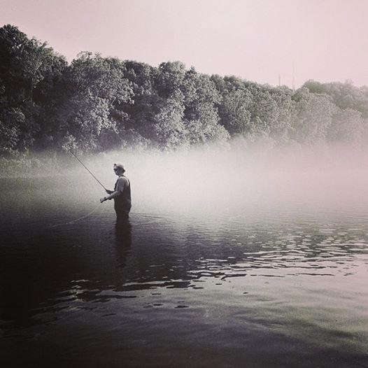 fisherman at Lake Taneycomo in Branson