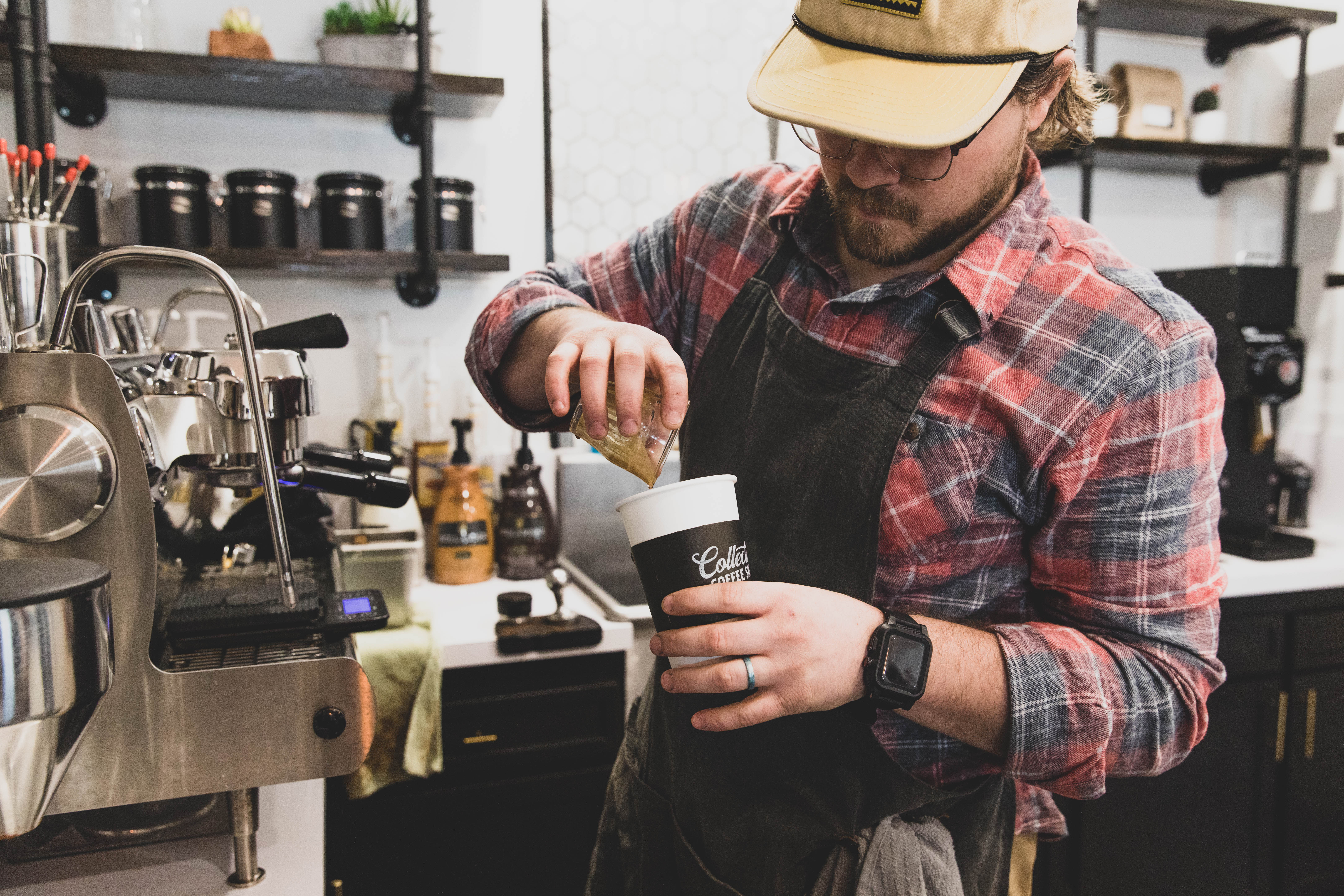 Male barista making a coffee at a new Branson coffee shop.