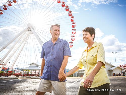 A couple walking to the Branson Ferris Wheel.