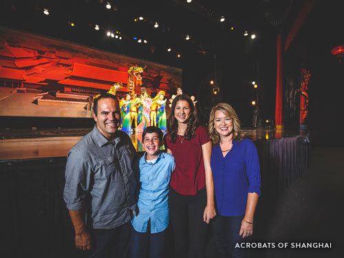 Family of four watching an acrobatic show in Branson.