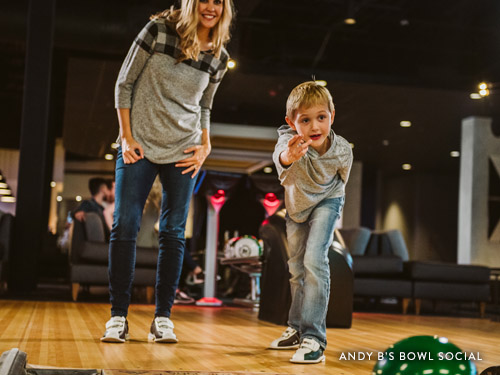 Mother and son bowling at Andy B's Bowl Social in Branson.