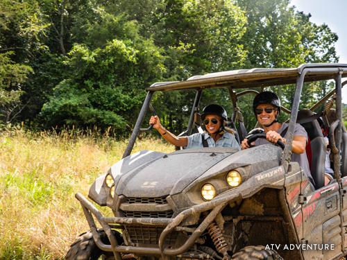 Family of four enjoying a thrilling ATV adventure in Branson.