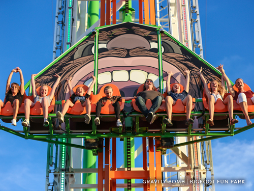 Group of people riding a tall thrill ride in Branson.