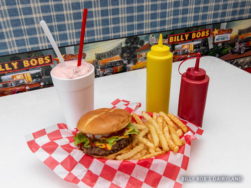 Hamburger, fries and a milkshake sitting on a table in a diner in Branson.