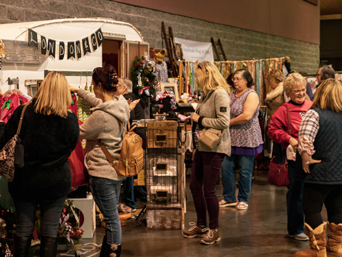 People shopping through over 200 booths of crafts at Branson Market Days.