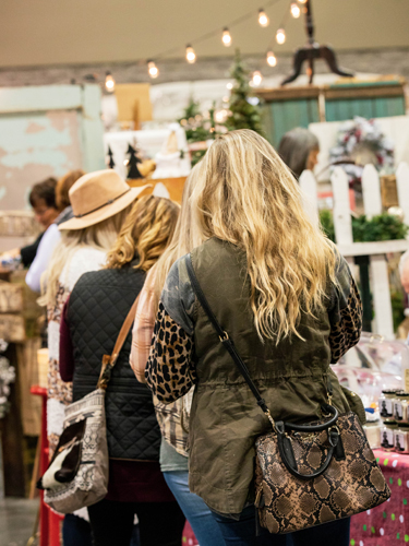 Women shopping for unique gifts at Branson Market Days.