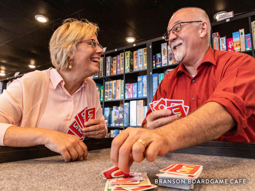 Middle-aged couple on a date and playing cards in Branson.