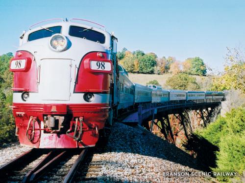 Train touring through scenic Ozark Mountains in Branson.