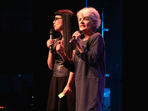 Two women performing on live show stage in Branson.