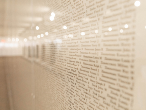 Wall displaying names of the fallen service men and women from World War II at a museum in Branson.