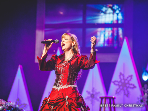 Woman singing at the Brett Family Christmas show.