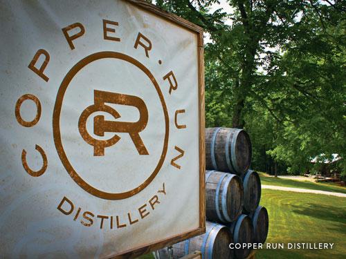 Wine barrels and sign from Copper Run Distillery in Branson.