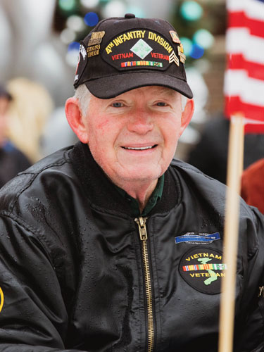 United States military veteran participating in the annual Veterans Day Parade in Branson.