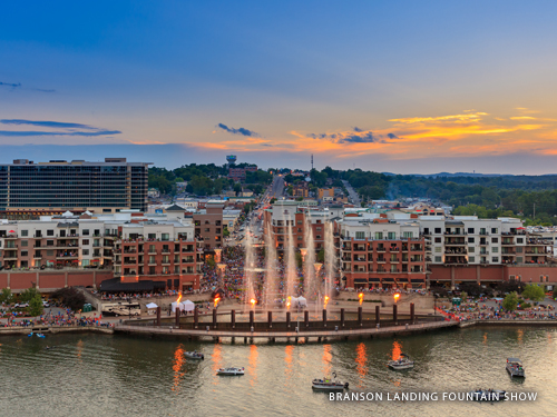 Fountain and fire show lighting up the night at Branson Landing in Historic Downtown Branson.