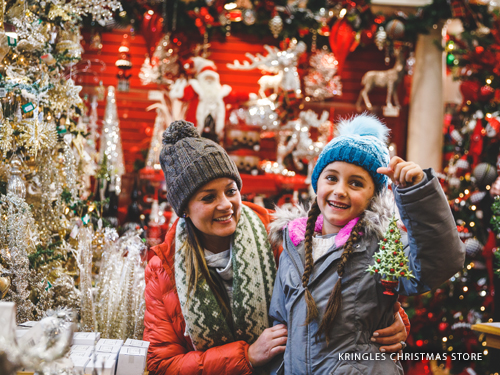 Mother and daughter holding a Christmas ornament in the largest Christmas store in Missouri found in Branson.