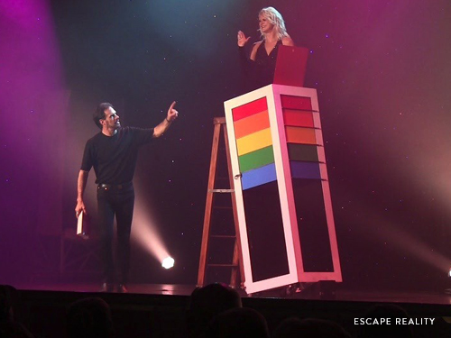 Man and women performing in magic illusion show in Branson.
