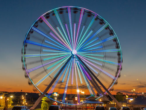 Branson Ferris Wheel lit up by 16,000 LED lights at night.