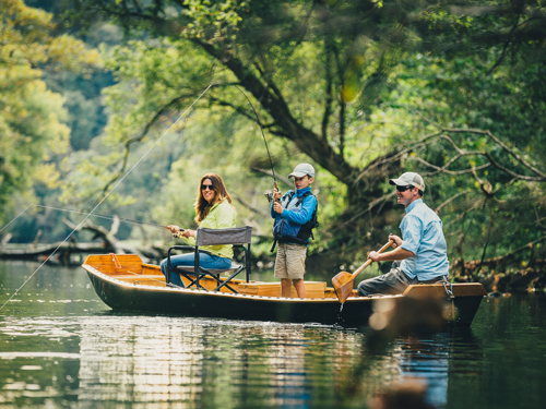 Family of three fishing in a cove on a lake in Branson.