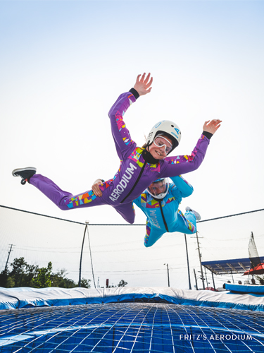 Young girl flying in a aerodium skydiving attraction in Branson.