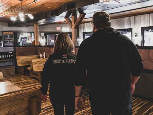 Husband and wife co-owners and chefs at a barbecue restaurant in Branson.