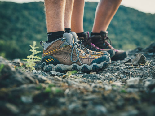 Close look of man and woman's hiking boots during a scenic hike in Branson.