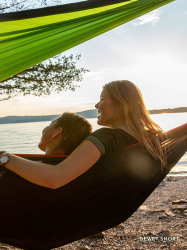 Two girls sitting in a hammock near Table Rock Lake.