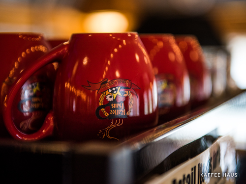 Upside down red coffee mugs in Branson coffee shop.