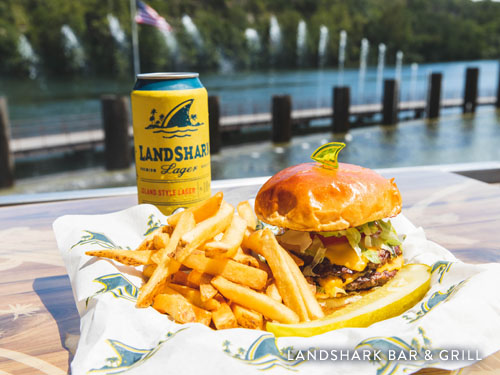 Food and drink served at Landshark Bar and Grill. Patio overlooking Branson Landing fountain show and Lake Taneycomo.