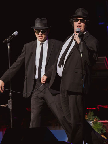 Blues Brothers tribute performing on a live show stage in Branson.