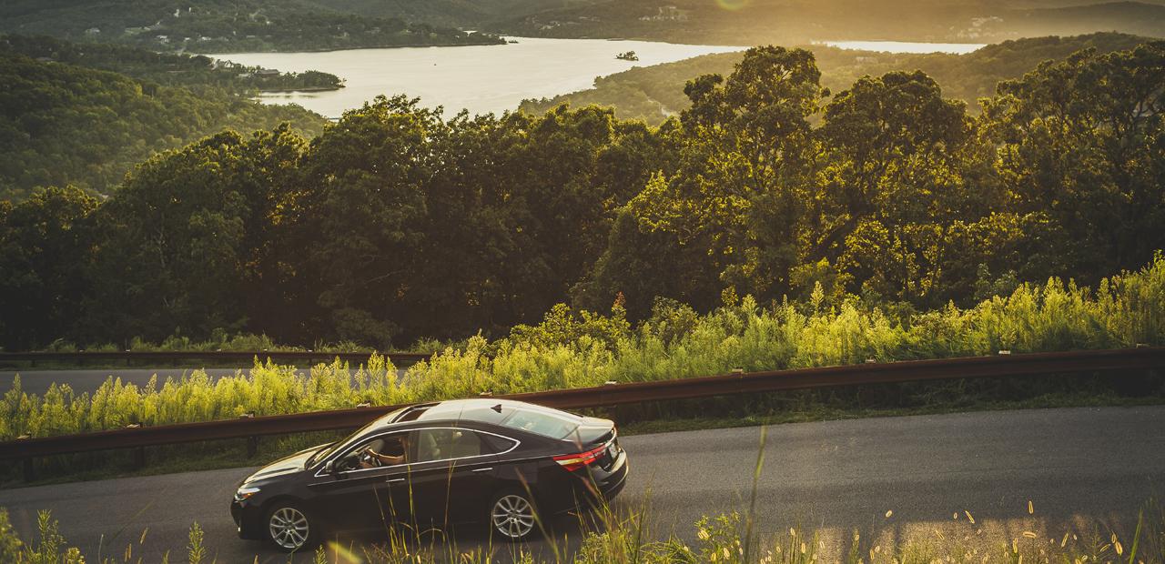 Car driving through the Ozark Mountains.