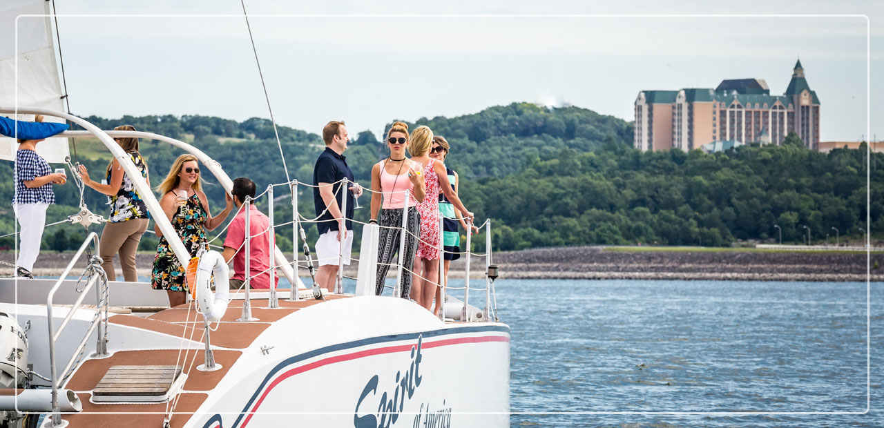 Group of business partners conversing on a catamaran in Branson.