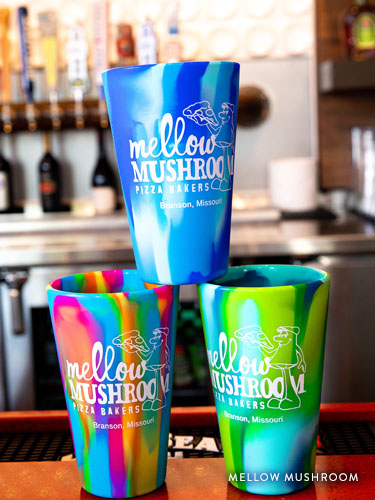 Three Mellow Mushroom alcohol cups stacked on the Dude's Daiquiri Bar.