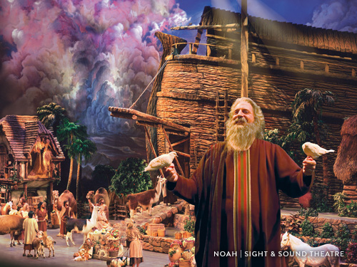 Actor portraying Biblical character performing on a stage with live animals and large props in Branson.