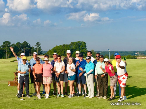 Group of business partners posing for picture at golf course in Branson.