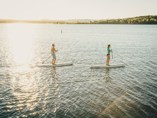 Man and woman paddleboarding in Branson.