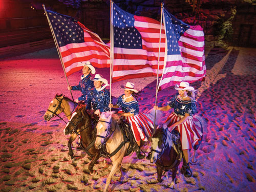 Four performers riding horses and singing in Branson show.