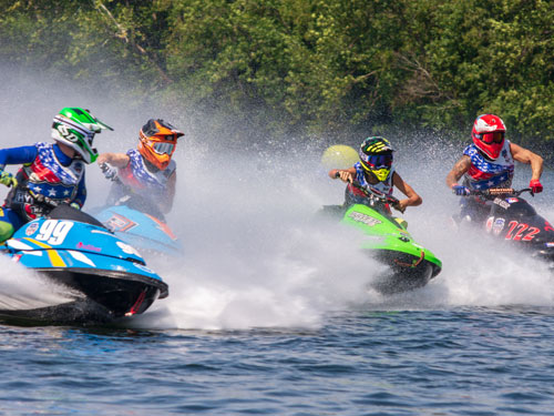 Four powerboat drivers racing in a powerboat race at Branson Landing in Branson.
