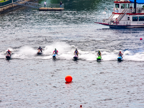 Six powerboat riders racing in a powerboat event on Lake Taneycomo in Branson.