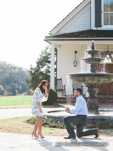 Man on one knee proposing to girlfriend.
