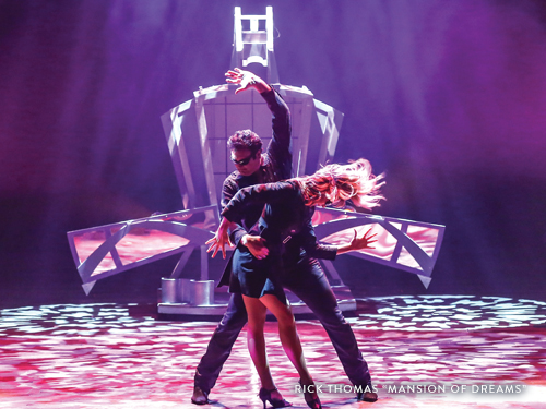Husband and wife dancing and performing magic and illusions in a Branson show.