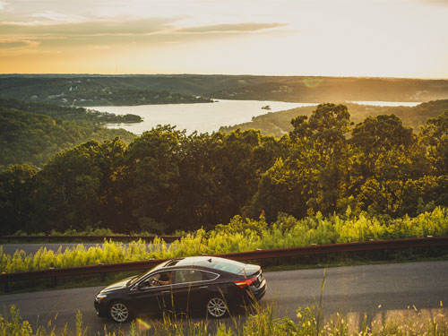 Car driving on scenic drive in Branson.