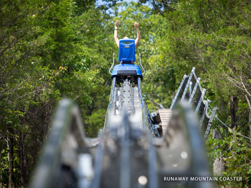 Blue mountain coaster car gliding on the track in Branson.