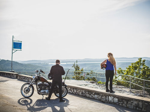 Man and woman stopped at a scenic overlook with their motorcycle in Branson.