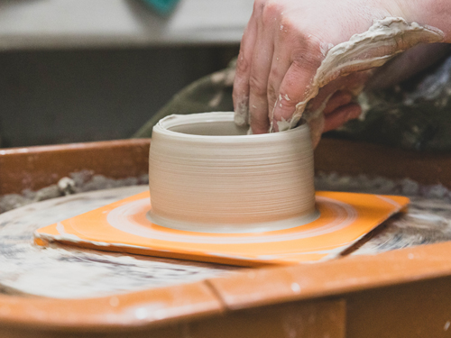 Man spinning pottery at an art studio in Branson.