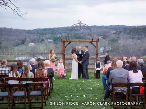 Outdoor wedding in the middle of scenic Ozark Mountains.