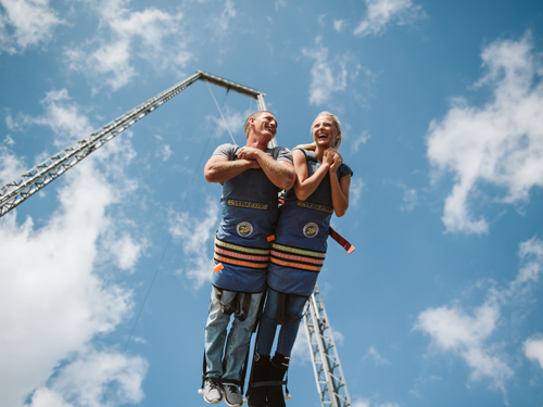Boy and girl strapped into large swinging attraction in Branson.