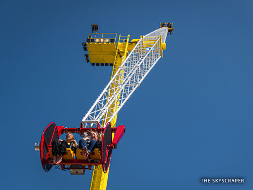 Four people riding a tall, spinning attraction in Branson.