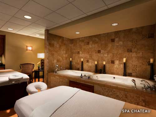 Hot tubs and massage tables for couple date night at Spa Chateau.