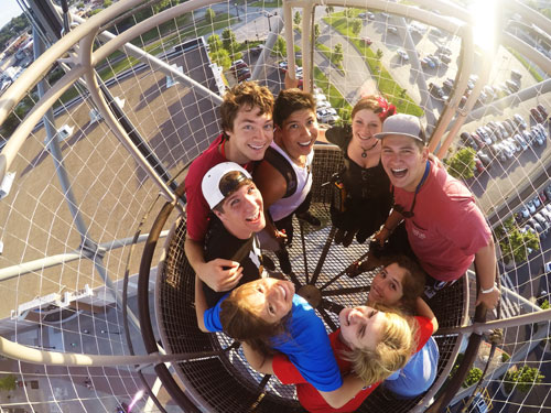 Large group of college-aged students riding a hot air balloon attraction in Branson.