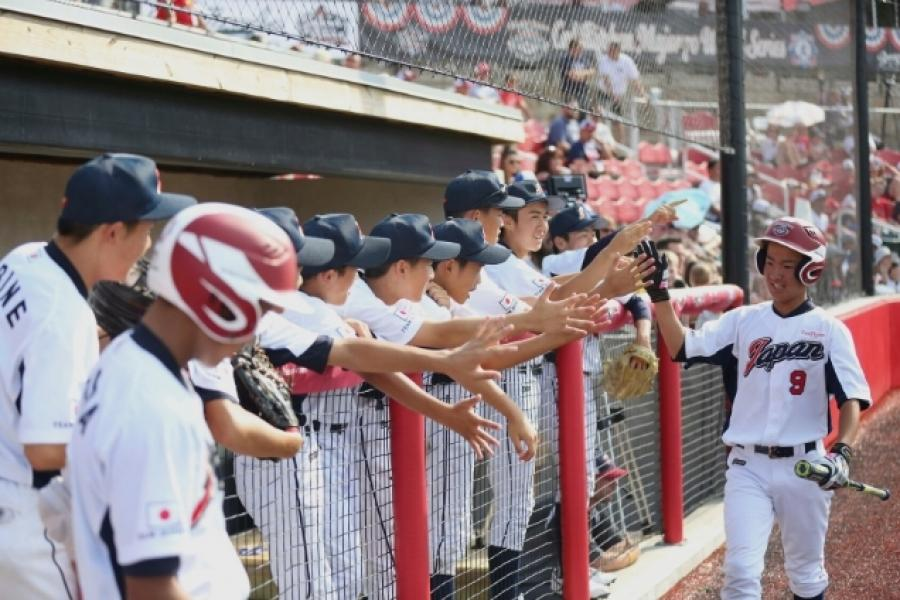 baseball team high fives on the ballparks of america field in Branson MO